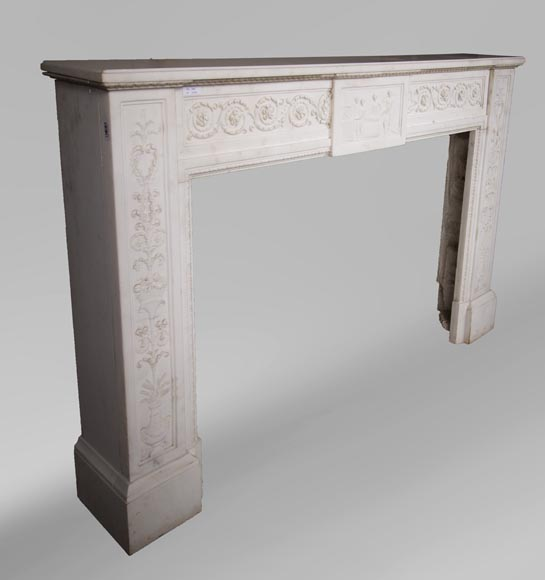 Carrara marble mantel with Vulcan's forge cartouche-5