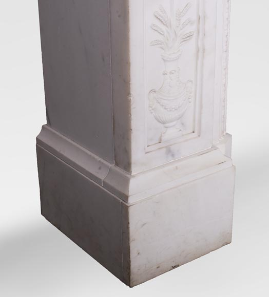 Carrara marble mantel with Vulcan's forge cartouche-8