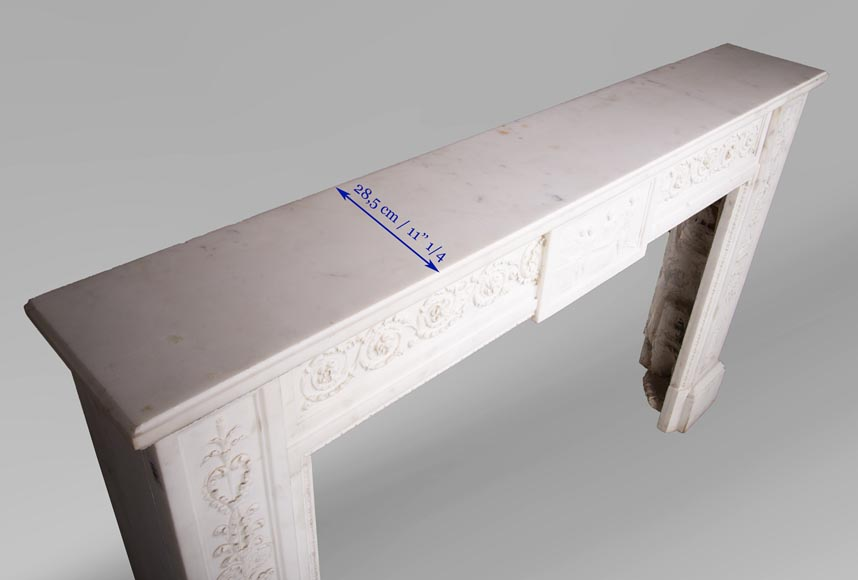 Carrara marble mantel with Vulcan's forge cartouche-13