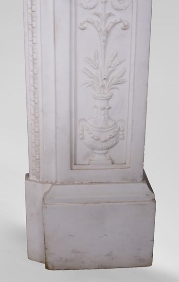 Carrara marble mantel with Vulcan's forge cartouche-11