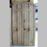Narrow wooden double door.