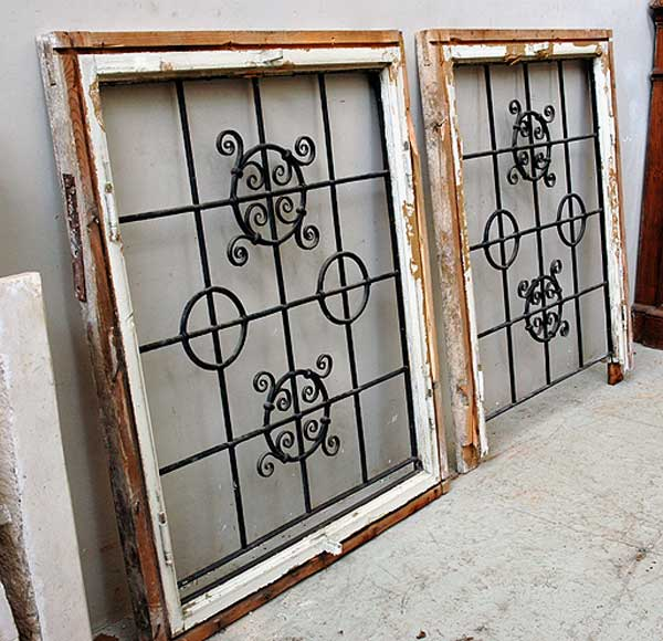 Pair of square wrought iron windows and shutters