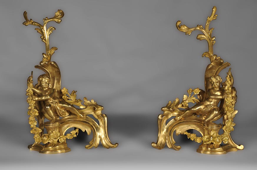 Antique Louis XV style andirons made out of gilded bronze with putti decor - Reference 10109