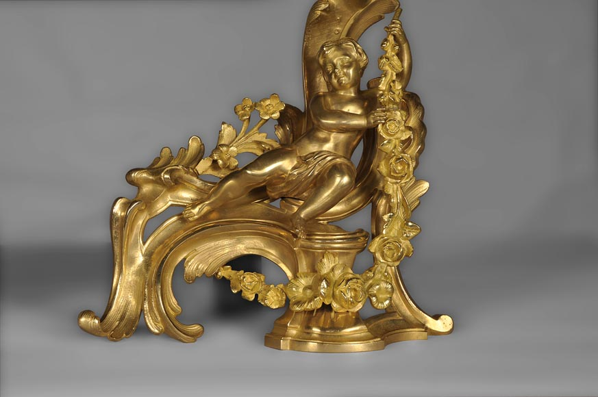 Antique Louis XV style andirons made out of gilded bronze with putti decor-4