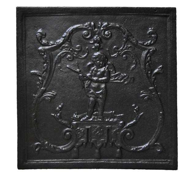 Small antique cast iron fireback with Cupid in a Rococo frame - Reference 10118