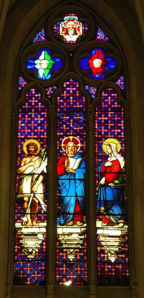 Stained glass window from a chapel with Jesus as central figure-0