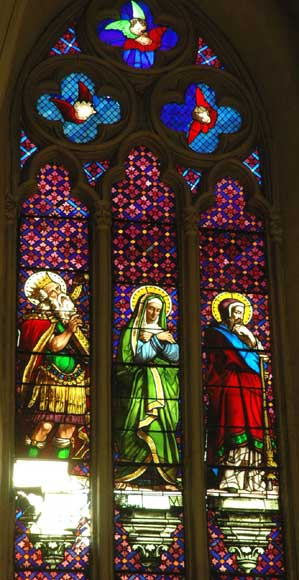 Stained glass window from a chapel with Mary as central figure-1