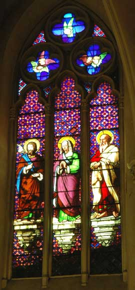 Stained glass window from a chapel with Saint Anne as central figure -0