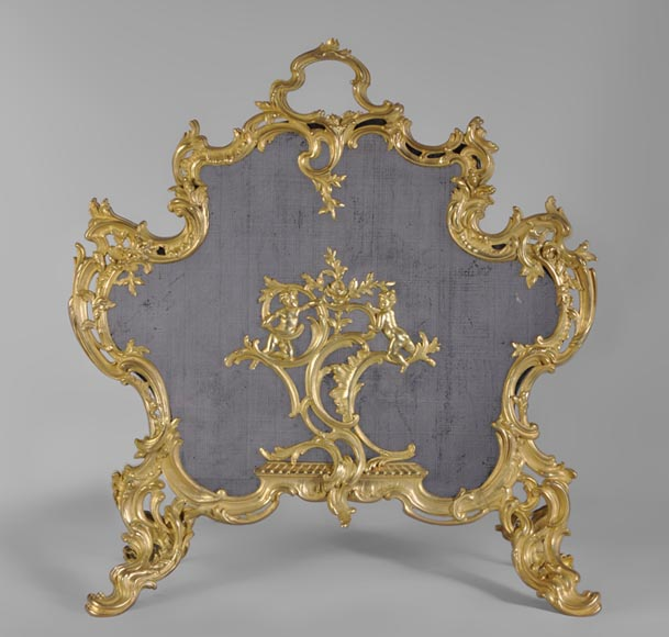 Fire screen Louis XV style gilt bronze with putti - Reference 10337