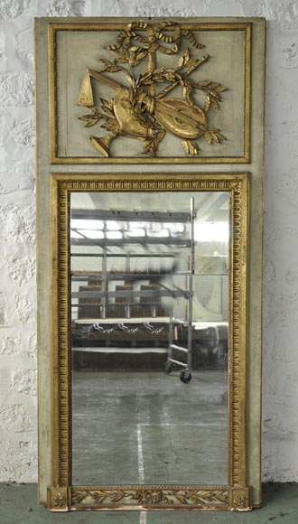 Beautiful 18th-century overmantel mirror, Louis XVI period, in carved wood with music instruments decor-0