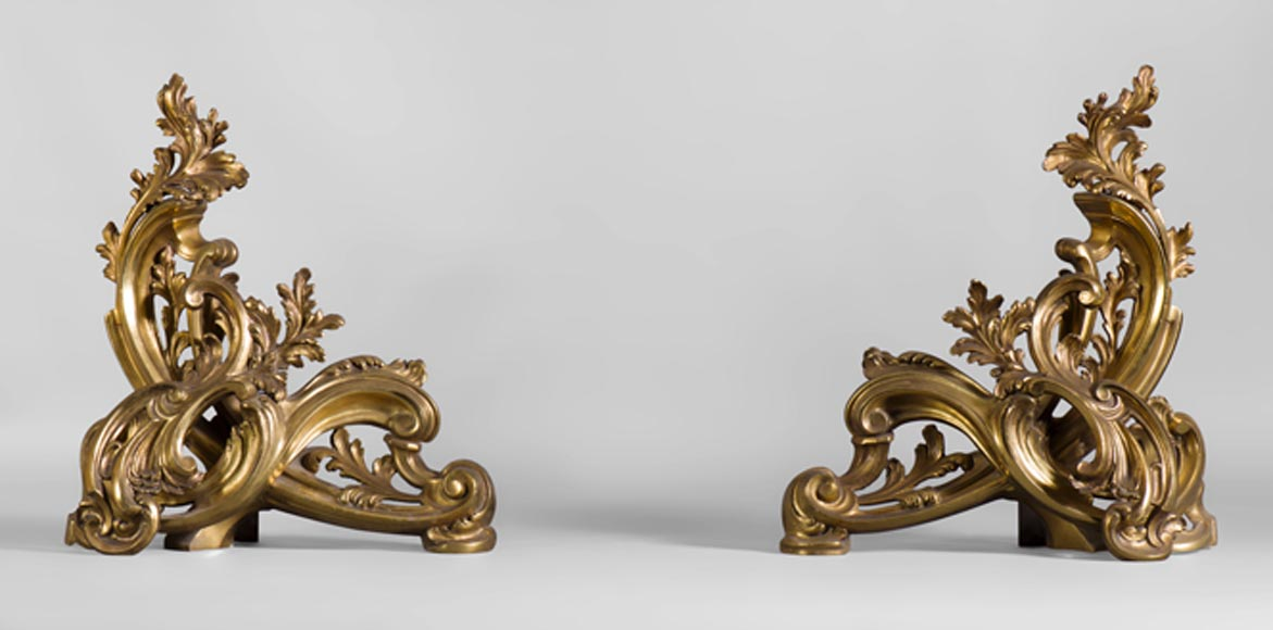 Antique pair of gilt bronze andirons with foliages, Louis XV style - Reference 10412