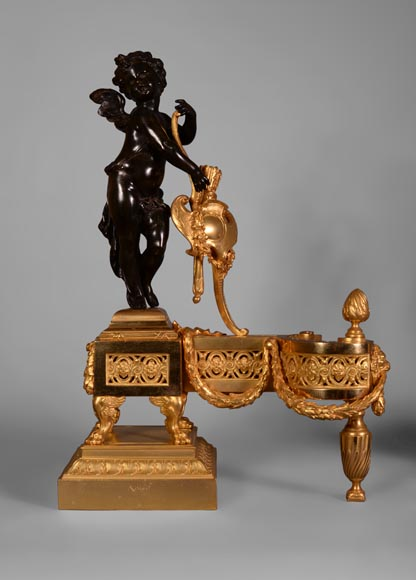 Pair of gilt bronze and patinated bronze andirons with Cupid signed
