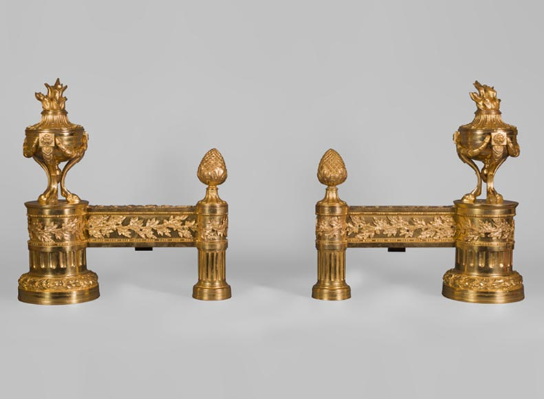 Antique pair of gilt bronze andirons, Louis XVI style, with fire pots decor - Reference 10429