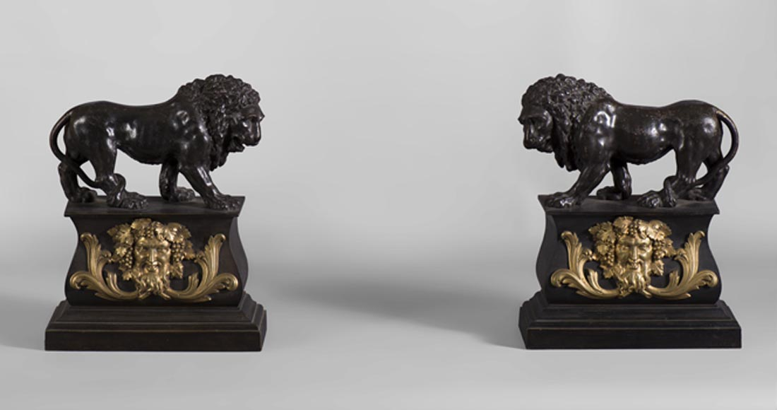Pair of antique andirons in patinated bronze and gilt bronze with lions and Bacchus' masks, from 19th century. - Reference 10431