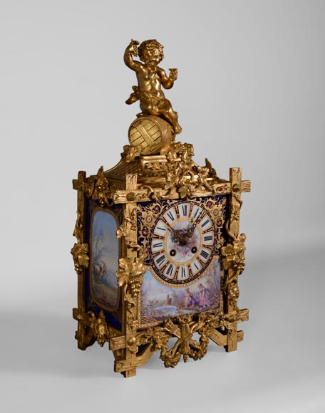 A Napoleon III style clock made out of porcelain and gilded bronze representing Bacchus, god of wine-1