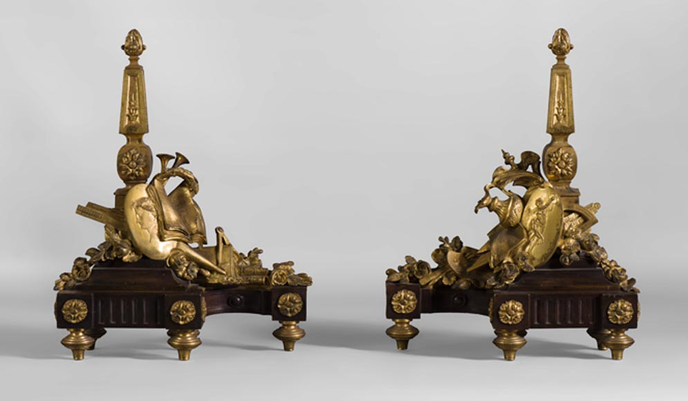 Pair of Louis XVI style andirons in patinated bronze and beautiful gilt bronze decoration depicting the attributes of the Arts - Reference 10461