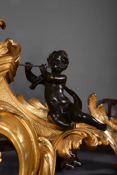 Antique pair of Louis XV style andirons in bronze with two patinas with putti playing music-2
