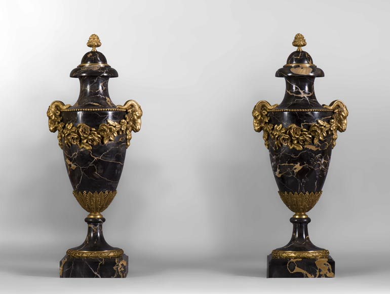 Pair of Portor marble cassolettes with rams' heads and garlands of flowers in gilt bronze -0