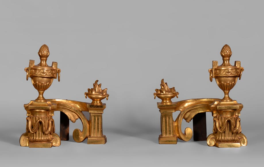 Antique pair of small gilt bronze andirons, Louis XVI style, decorated with fire pots and covered vases - Reference 10547