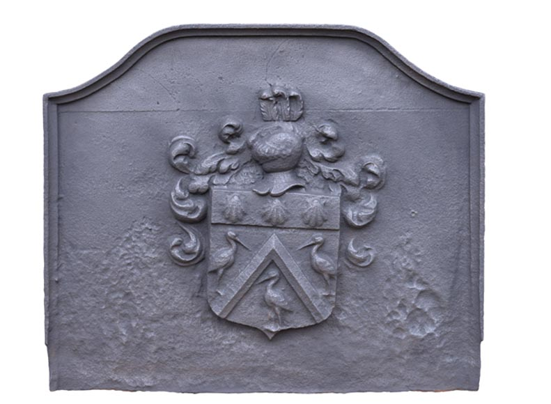 Large antique cast iron 18th-century fireback with coat of arms and knight's helmet - Reference 10558