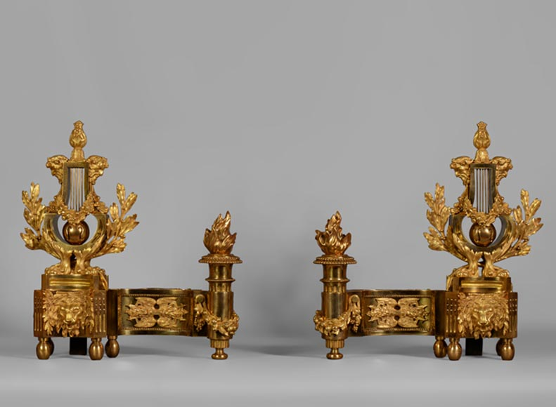 Sumptuous antique pair of Louis XVI style andirons with lyre, gilt bronze, 19th century - Reference 10590