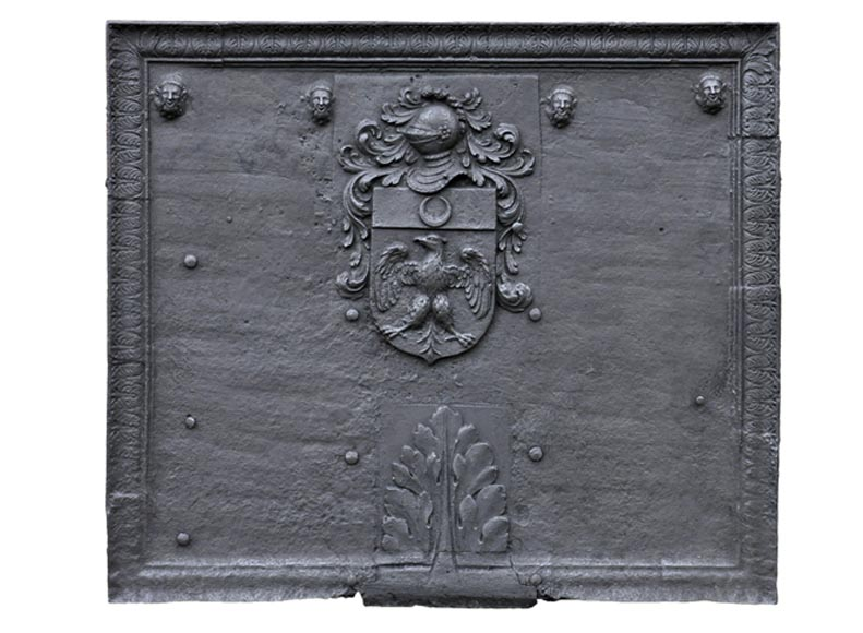 Large antique cast iron 17th-century fireback, coat of arms with a knight's helmet - Reference 10599