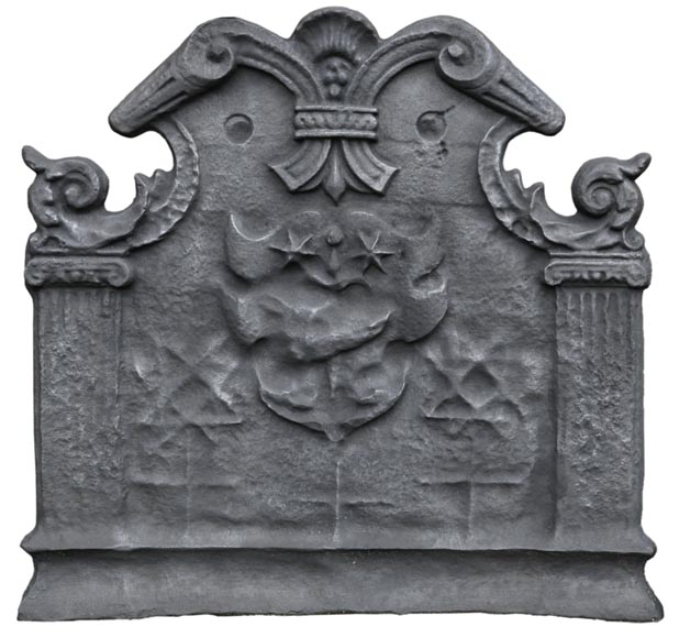 Antique cast iron fireback with coat of arms with a sword and two stars, two ionic pilasters and leather cut pattern, late 17th century -0