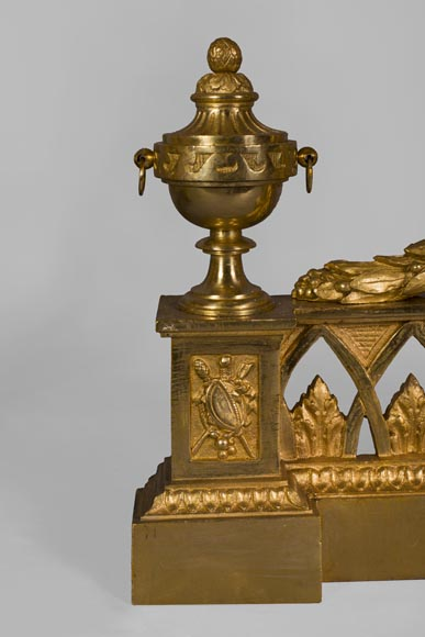 Antique Louis XVI style gilt bronze fire fender with urns on fire
