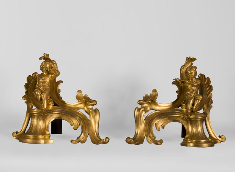 Superb pair of Louis XV period gilt bronze andirons with putti blowing soap bubbles, 18th-century original gilt - Reference 10729