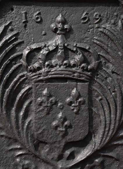 Antique cast iron fireback with the French coat of arms dated 1659-1