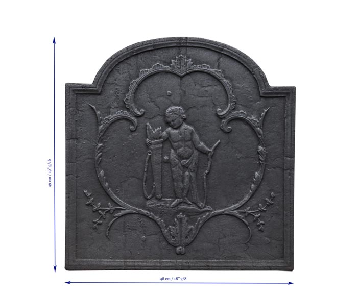 Small antique cast iron fireback featuring Cupid-7