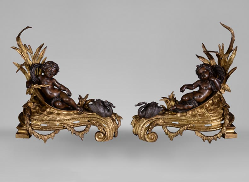 Very beautiful antique pair of andirons in bronze with two patinas with decor of putti and swans - Reference 10828