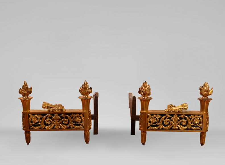 Antique pair of Louis XVI style andirons in gilt bronze with quivers and beautiful flames - Reference 10881