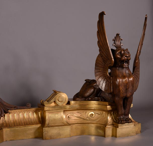 Antique pair of Napoleon III style fire fender made of gilt bronze and brown patina bronze with winged lions-2