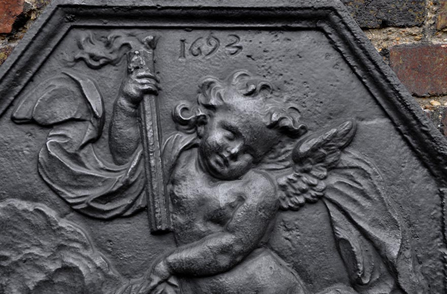 Antique fireback dated 1693 with winged putto holding a torch-1