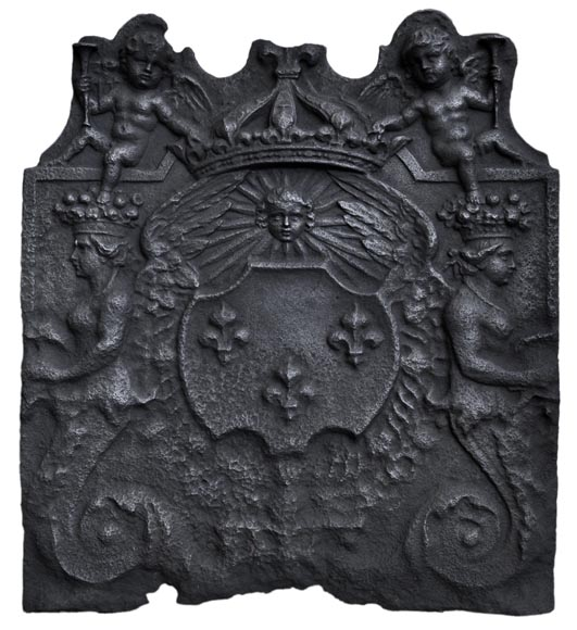 Antique fireback with French coat of arms and rich decor with cupids, 17th century-0