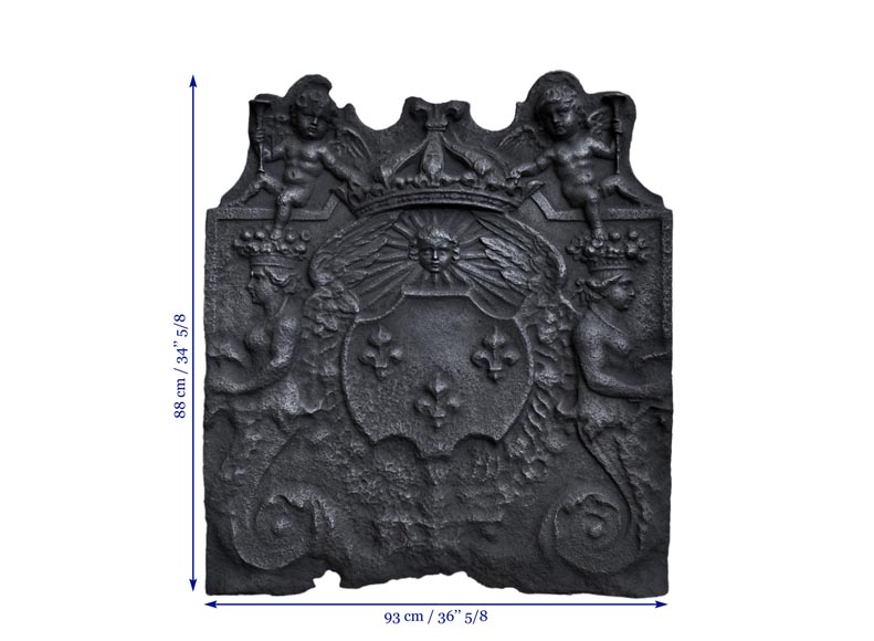Antique fireback with French coat of arms and rich decor with cupids, 17th century-11