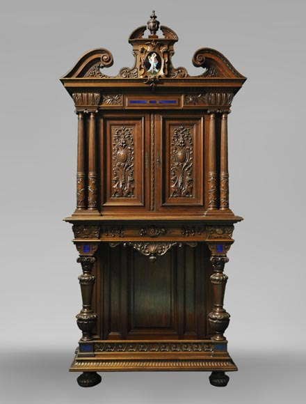 Two-body cabinet, in th Neo-Renaissance style, in carved walnut with enamel and lapis-lazuli inlays-0