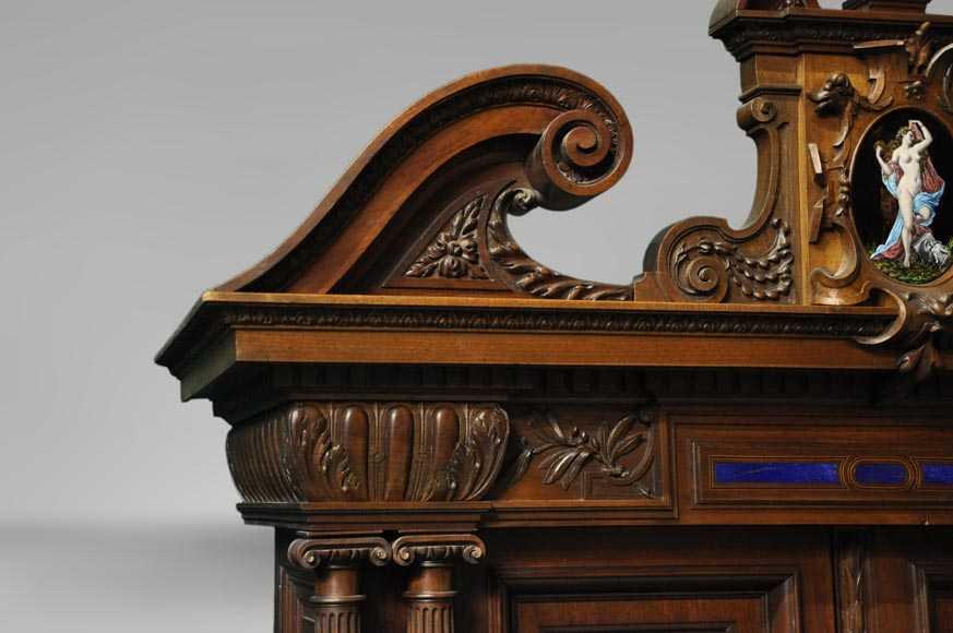 Two-body cabinet, in th Neo-Renaissance style, in carved walnut with enamel and lapis-lazuli inlays-2