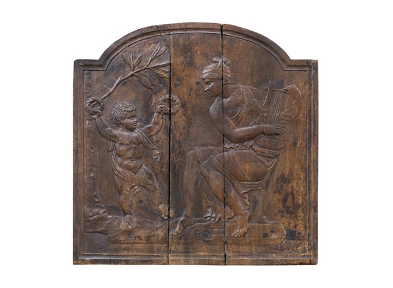 Antique fireback's mould carved in walnut with putto crowning Euterpe, the Muse of Music-0