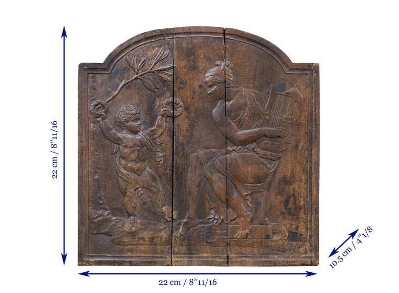Antique fireback's mould carved in walnut with putto crowning Euterpe, the Muse of Music-5