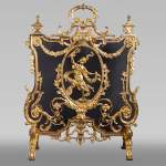 Antique Napoleon III style firescreen made of gilt bronze with dancer