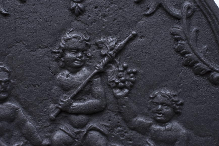 Antique fireback representing Bacchus as a child-3
