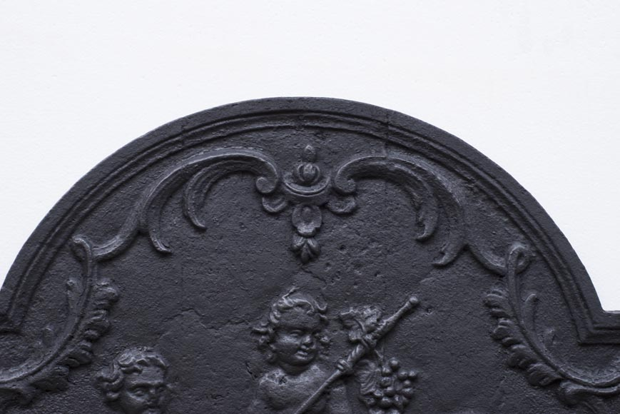 Antique fireback representing Bacchus as a child-4