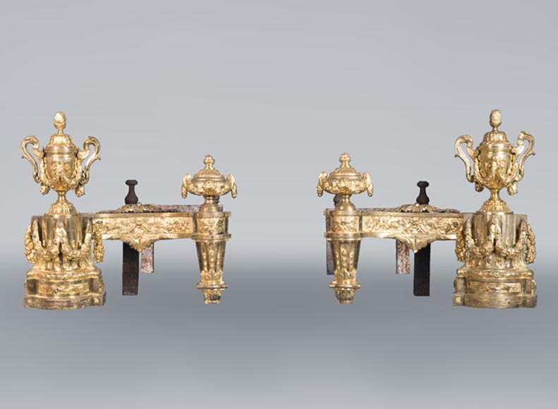 Beautiful pair of antique Louis XVI style andirons in gilt bronze from the 19th century decorated with vases and floral garlands-0