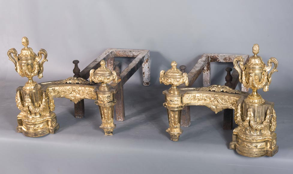 Beautiful pair of antique Louis XVI style andirons in gilt bronze from the 19th century decorated with vases and floral garlands-1
