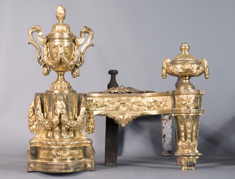 Beautiful pair of antique Louis XVI style andirons in gilt bronze from the 19th century decorated with vases and floral garlands-2
