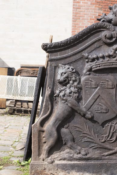 Imposing cast iron fireback with two lions holding two coats of arms-1