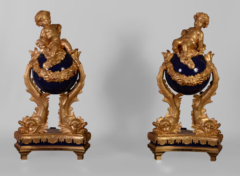 Exceptional pair of Napoleon III style andirons with putti made of gilt bronze and blue lacquered bronze -0