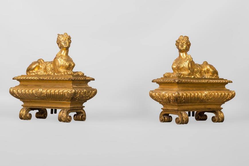 Pair of chenets with sphinges, Regency style, in gilded bronze-1